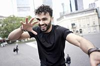 young Moroccan man feeling excited in Frankfurt am Main, Germany