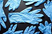 Latex gloves on a black table.
