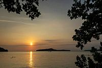 view from rustic wood sun deck on Koh Ta Kiev island near Sihanoukville in Cambodia at sunset.