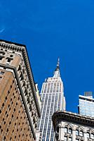 Low angle view of buildings against sky in Midtown of Manhattan in New York.