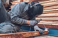Welding work, Man Welding in Workshop. Metalwork and Sparks. Construction and Industrial concept .