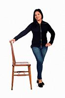 woman playing with a chair in white background, front view,.