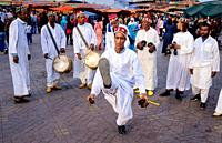 Men playing drums and performing a traditional dance in the Jemaa el Fna, Marrakech, Morroco, North Africa.
