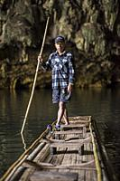 A boatman at the inside the Tham Lot cave, Pang Mapha, Pai, Thailand.