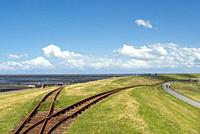Dike by Luettmoorsiel with rails of the Hallig Railway, also called Lorenbahn, Reussenkoege, Schleswig-Holstein, Germany, Europe.