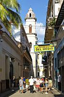 The famous Bodeguita del Medio and the bell tower of the cathedral behind. Habana Vieja, Havana, Cuba.
