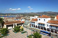 View of Santiago de Cuba. In the foreground the Parque Céspedes with the town hall on the right and the Casa Velázquez which is Cuba's oldest resident...