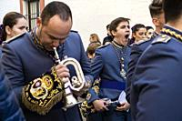 Music band follows the religious procession. Carmona, Andalusia. Spain.