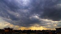 Heavenly Sun Rays Through Dark Clouds Against The Blue Sky. selective focus.