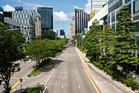 Singapore, Republic of Singapore, Asia - Empty streets and hardly any traffic in the downtown core along Eu Tong Sen Street during the partial lockdow...