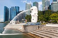 Singapore, Republic of Singapore, Asia - Abandoned Merlion Park with fountain along the banks of the Singapore River and skyscrapers of the central bu...