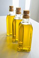 Three oil bottles with olive oil. Spain.