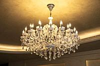 Chandelier with candlelike lights.