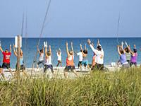 Morning Yoga on Englewood Beach on Manasota Key on the Gulf of Mexico in Englewood FLorida in the United States.