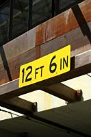 12ft 6in yellow sign above a tunnel entrance in downtown Tucson, AZ.