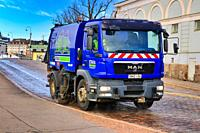 Blue MAN TGM 15. 240 street washer truck of Stara, City of Helsinki City Construction Services, washing streets in Helsinki, Finland. May 12, 2020.