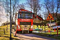 Red Volvo FH with lorry mounted Palfinger crane of Eilola Logistics Oy at the work site on in Helsinki, Finland. April 21, 2020.