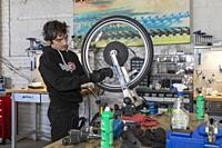Detroit, Michigan - Maintenance of a bicycle in Detroit's MoGo bike share system.