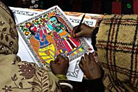 Drawing lesson in a Madhubani style drawing school ( Madhubani, Bihar, India). The Madhubani ( or Mithila) style of painting is an art form practiced ...