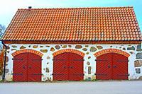 Stonehouse wit three doors in Glemmingebro, Scania, Sweden, Scandinavia.