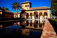 El Partal palace with the portico and the Las Damas tower. The Alhambra. Granada.