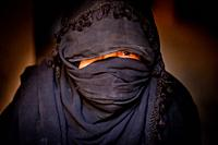 A woman of Arab descent photographed in a remote village in Southern Morocco, North Africa.