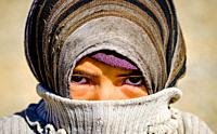Portrait of a young nomadic woman in the Dades Valley in southern Morocco, North Africa.