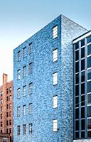 Modern office building laid with blue bricks in downtown Buffalo, NY.