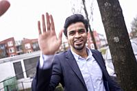 Indian businessman giving high five in Leeuwarden, Friesland, Netherlands, Europe.