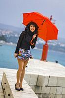 Teen girl with Red umbrella in hands