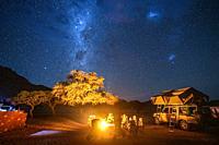 Campers set up under the Milky Way , Helmeringhausen, Namibia.