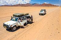 A small caravan on an expedition across the desert , Namib-Naukluft Park, Namibia.