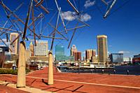 The skyline of Baltimore, Maryland rises along Inner Harbor.