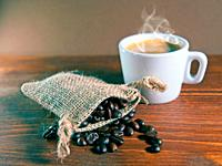 Espresso Coffee Cup with jute sack of roasted coffee beans.