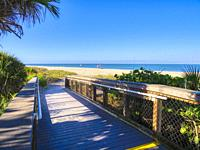 Entrance walkway to Blind Pass Beach on Manasota Key on the Gulf of Mexico in Englewood FLorida in the United States.