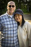 portrait of a couple, man 66, woman, 48.