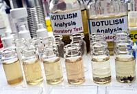 Samples contaminated by Clostridium botulinum toxin that causes botulism in humans, laboratory research, conceptual image.