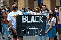 Young couple activists with protest board Black Lives Matter.