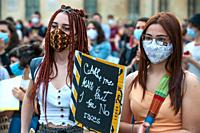 """Young women activist with surgical mask at a """"""""Black Lives Matter"""""""" flash mob."""