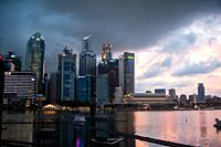 Singapore, Republic of Singapore, Asia - View of the illuminated city skyline with its skyscrapers of the central business district at Marina Bay duri...