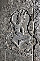 Bas-relief of a dancing Apsara (celestial dancer) at Angkor Wat temple complex. Angkor Archaeological Park, Siem Reap Province, Cambodia.