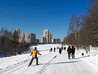 Man skiing in Bitsevski Park (Bitsa Park) on a sunny winter day. Moscow, Russia.