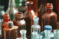 Many Old Medical Glass Capacity. Detail Of Retro Chemical Pharmaceutical Science Researches. Many Small Vintage Bottles And Glassware Different Sizes ...