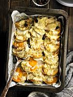 Calabaza gratinada con queso gruyere y olivas negras