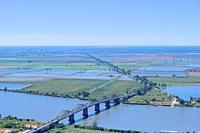 The farming fields outside Vila Franca de Xira by the Tagus River, with the Marechal Carmona bridge.