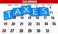 Income tax as a concept in the background calendar.