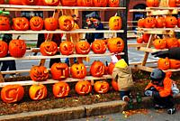 Kids enjoy carving their pumpkin at a festival in Keene, New Hampshire.