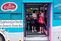 School girls on a university bus. Siam Square. Bangkok. Thailand.
