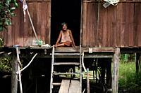Old woman in her hut. Damnoen Saduak floating market. Thailand.