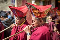 Buddhist Monk with an ornate hat watching the Korzok Gustor, Korzok Gompa, Lake Tsomoriri, (Ladakh) Jammu & Kashmir, India. Tsomoriri Lake, (Ladakh) J...